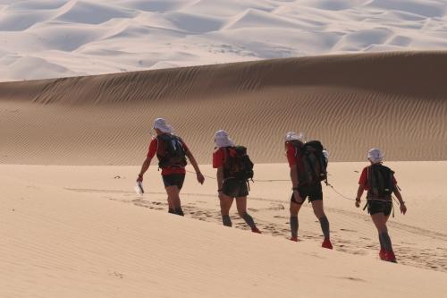 Trekking in the empty quarter desert at the Abu Dhabi Adventure Race