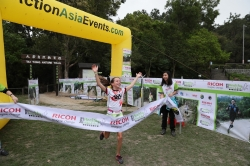 Pauline Courret crosses the line to win