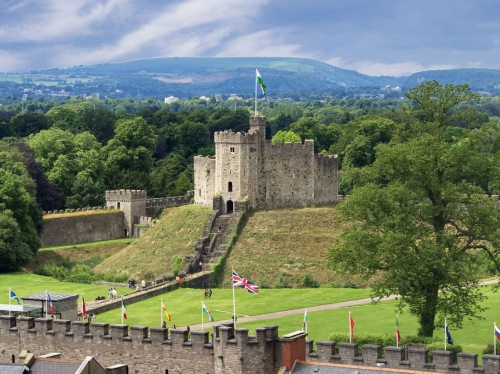 Cardiff Castle with hills and mountains in the background - copyright Brian Phillips & picfair.com