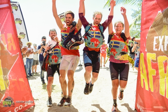 Greener Adventure Team cross the line to win