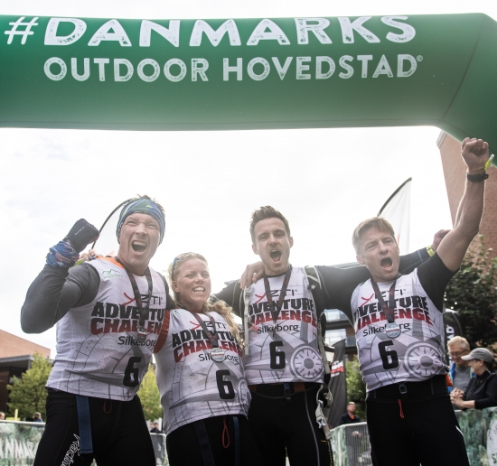 Team Racing Denmark Adventures celebrates their hard fought victory at the finish line in Silkeborg