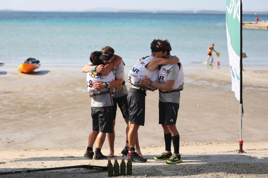 Team USWE on the finish line on the beach