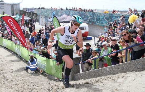 Emma Wilson crosses the finish line at New Brighton