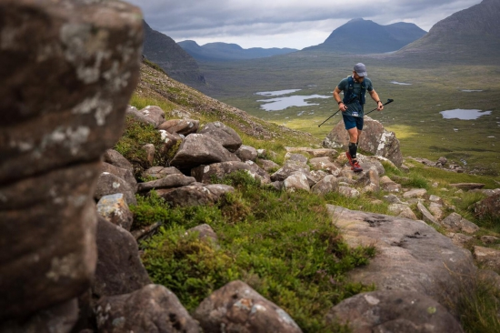 Charles Smith passing through the Torridon hills - second placed male on day 2