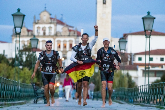 Team OMM Nordisk Germany run into the finish